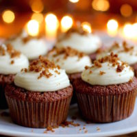 Light, fluffy fresh ginger gingerbread cupcakes spiked with lemony cream cheese frosting. Perfect for the holiday season.