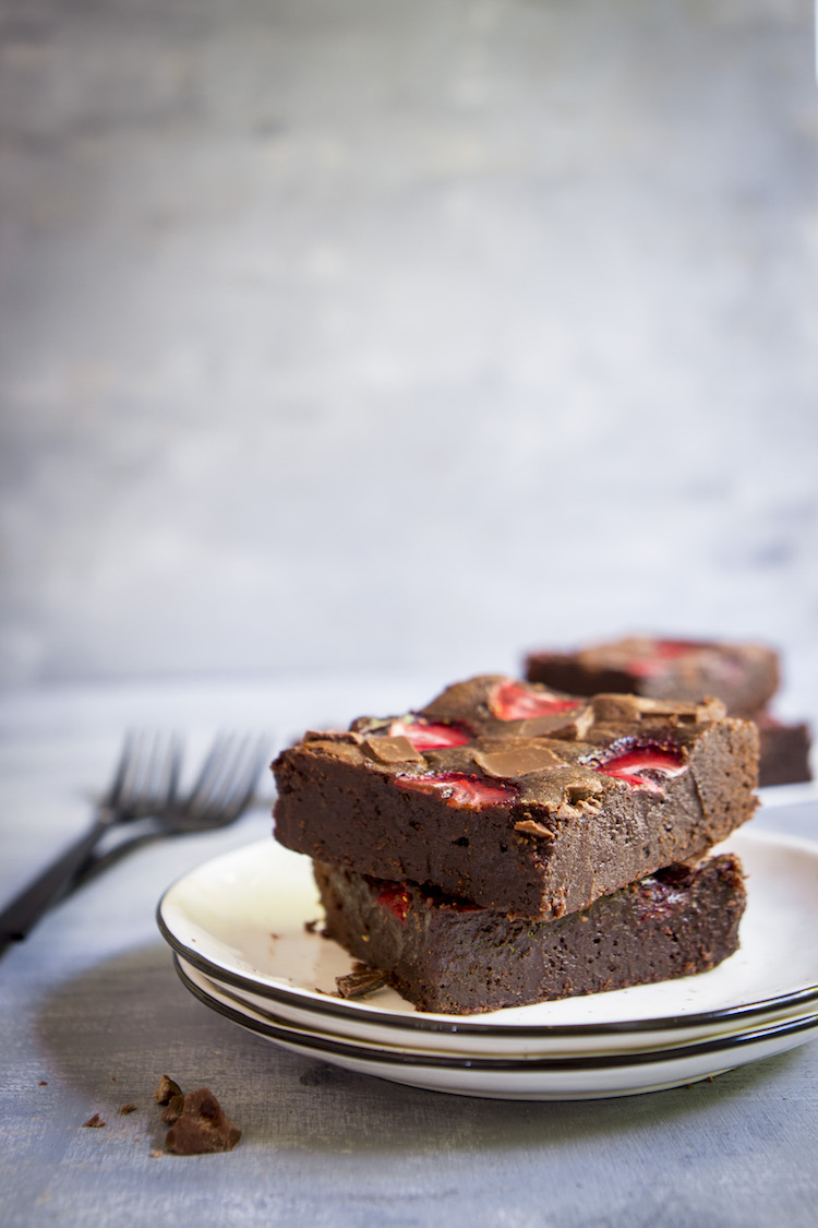 Thick, fudgy chocolate brownies topped with strawberries for an ultra-decadent summer treat.