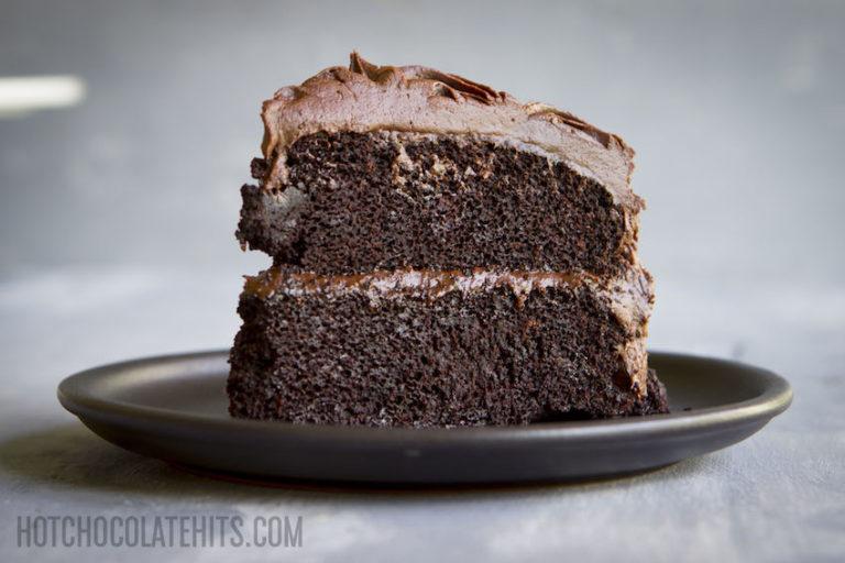 a slice of dark, decadent vegan chocolate cake