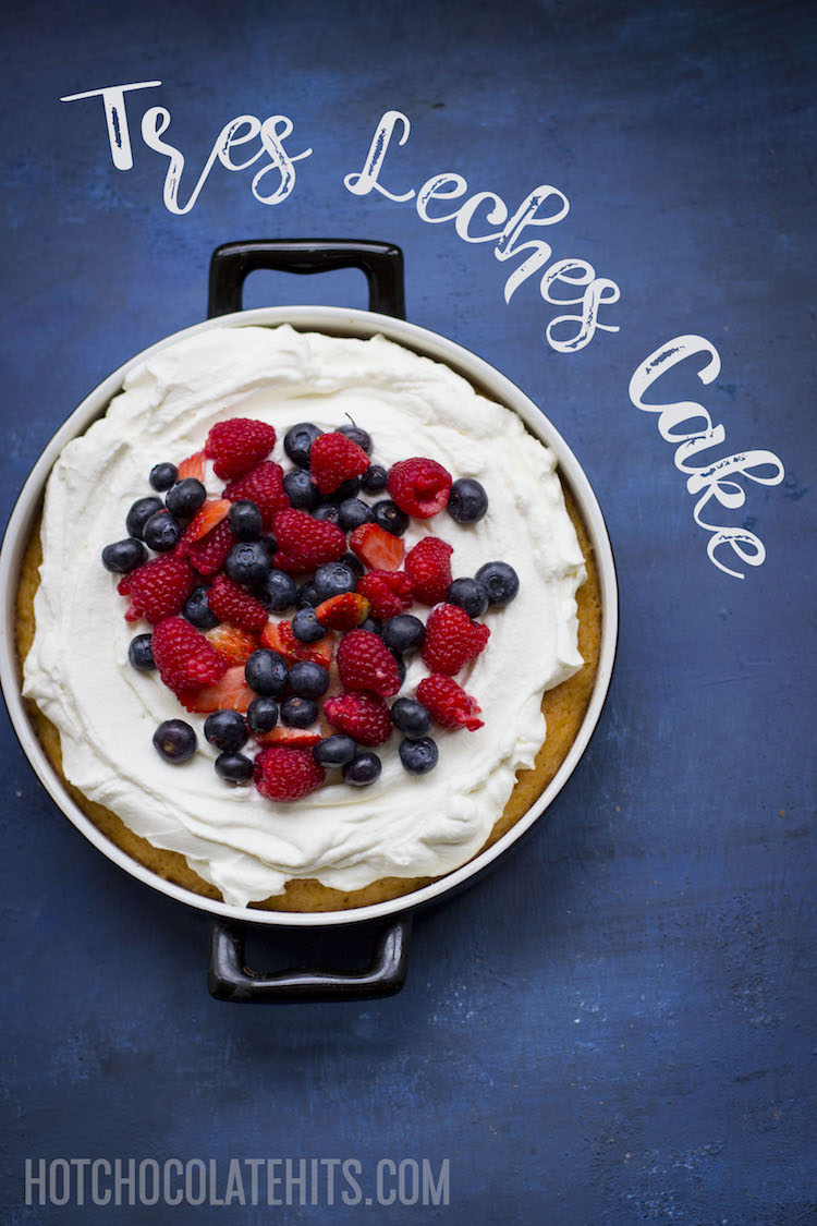 tres leches cake with whipped cream and fruit