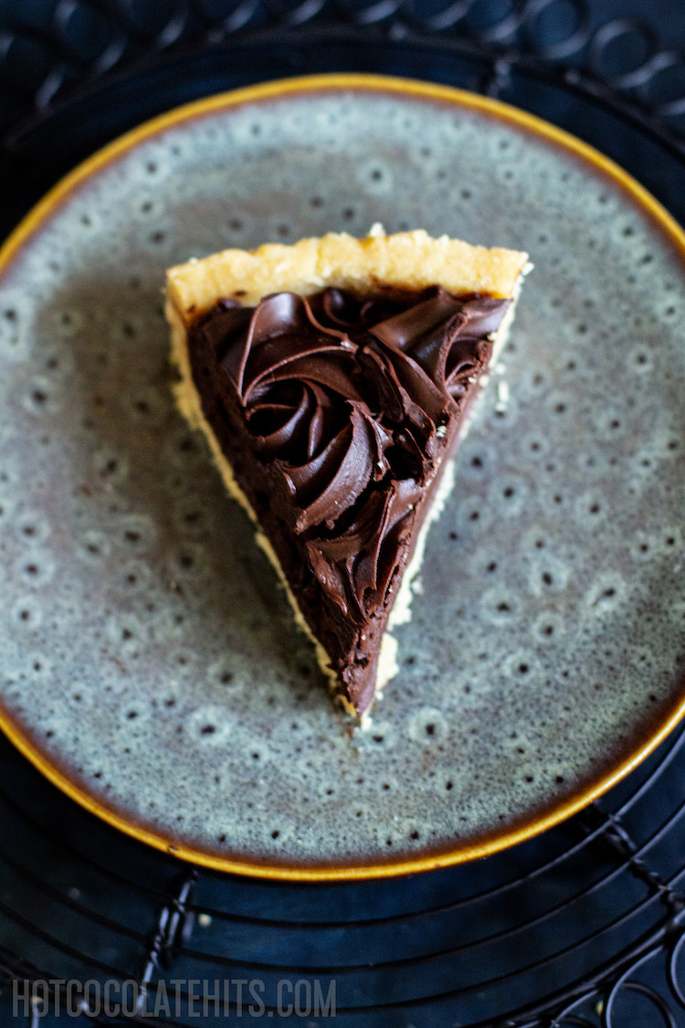 a picture of a slice of the no bake chocolate tart