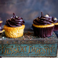 Fluffy vanilla cupcakes topped with chocolate buttercream.